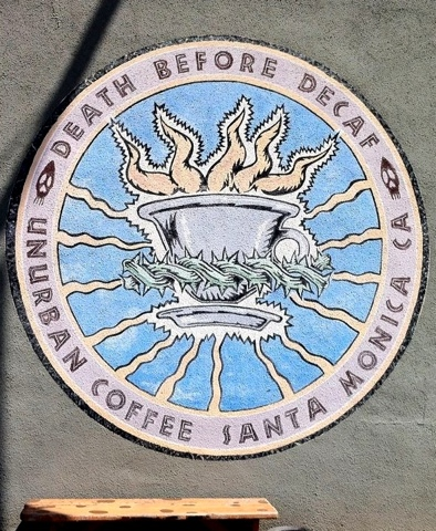 Sign for coffee shop, reads 'Death Before Decaf'